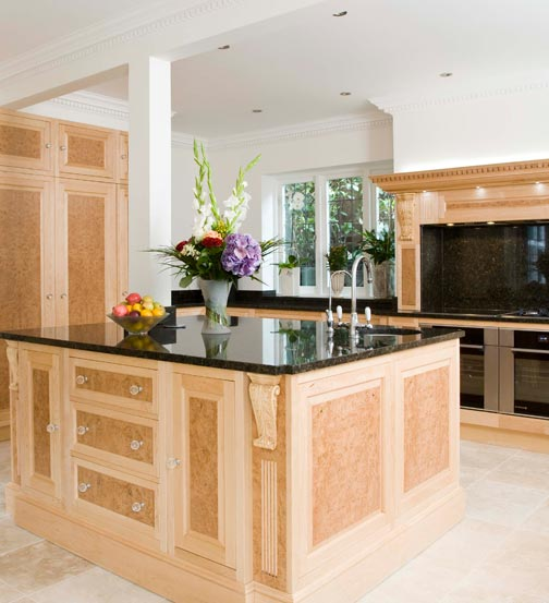 Maple veneered kitchen with burr oak drawer and cabinet fronts