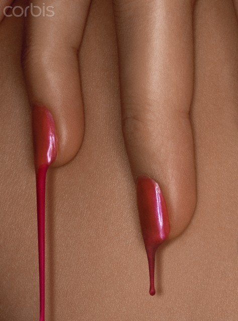 Red fingernails are pretty.