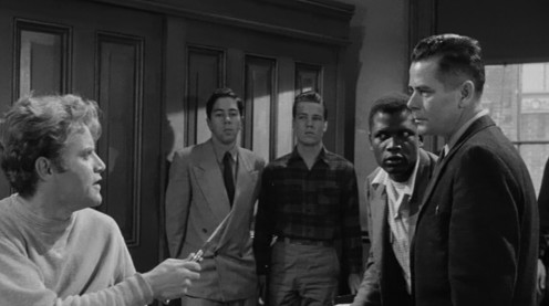 Vic Morrow threatens  Glenn Ford who plays  a teacher in thug- related film, Blackboard Jungle.