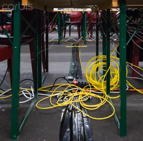 Computer cabling  like this can lead to  employees falling down  or even starting a fire.