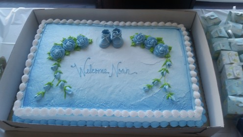 Simple and to the point baby shower cake! It was half vanilla and half chocolate and absolutely yummy!