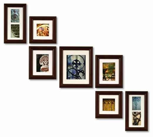 Many picture frames but in various sizes, and all one color. Creating an elegant organized way to display your photos.