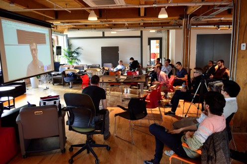 A multi-site (2 offices and a remote speaker = 3 sites in total) video conference meeting facilitated by Google Hangouts.