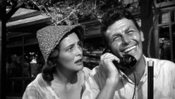 """Patricia Neal, """"Marcia Jeffreys,"""" Andy Griffith, """"Larry 'Lonesome' Rhodes,"""" in scene from """"A Face in The Crowd."""""""