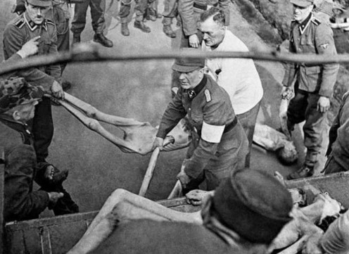 Allied troops force German troops to load the remains of the people who they helped to murder in the vile concentration camps. You do read what you sow.