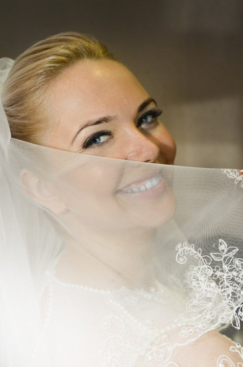 This bride is smiling because she received all of the gifts that brides love.