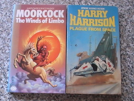 A couple of modern sci fi paperbacks with covers typical of the genre.