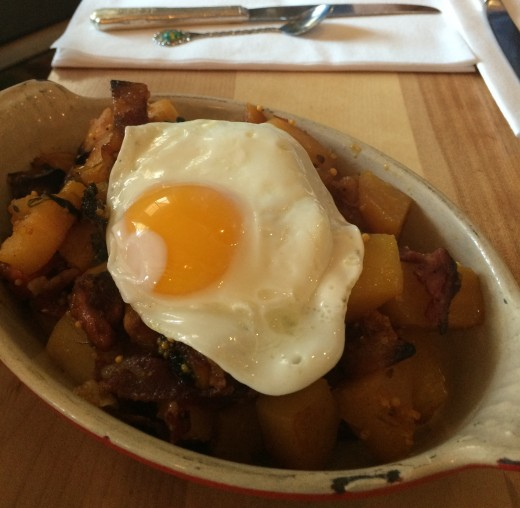 Mallard Cottage's Hash Skillet - roasted root vegetables, topped with house-made pastrami, honey mustard sauce and a sunny-side up fried egg!