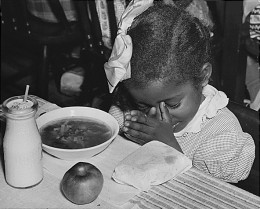 Photo of a young girl receiving a school-provided lunch in 1936