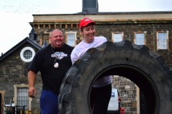 A weightlifter is introduced to a huge tire to help him in training to compete in The World's Strongest Man Competition.