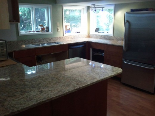 Pristine countertops make this kitchen more appealing.