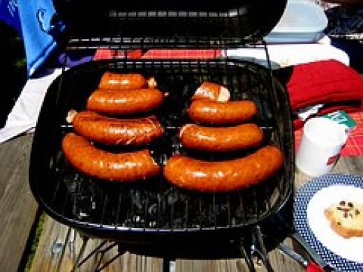 Smoked sausage cooked on a portable grill