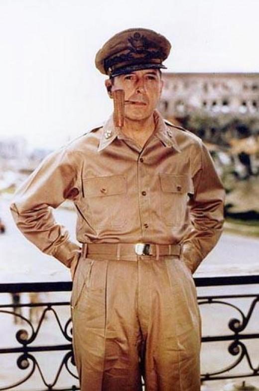 General of the Army Douglas MacArthur smoking his corncob pipe.