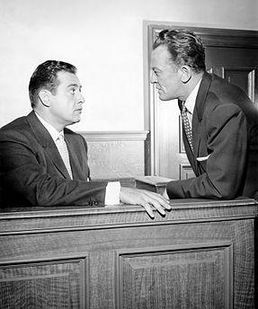 Perry Mason, (Raymond Burr), William Talman, (Hamilton Burger), appear in a heated scene from Perry Mason.