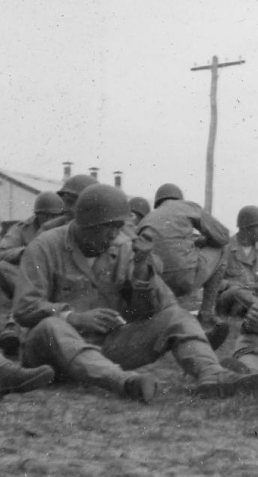 World War II Soldier in Philippines holding a cigarette while eating.