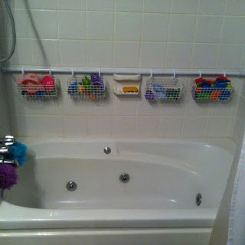 Putting hooks around the tub is another idea to consider. Little ones with lots of bath toys have a way to hang wet ones up to dry