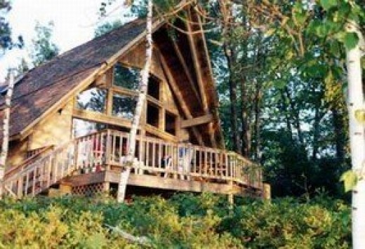 The house is located in a very private, wooded setting, on a small island with a drivable causeway and bridge.