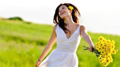When a girl dances in an open meadow, she is very happy.
