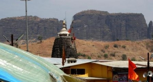 Bramha Giri seen in the background; on the foreground is the top of the Temple of Lord Trimbakeswara, the 10th Jyotirlingam of Lord Shiva