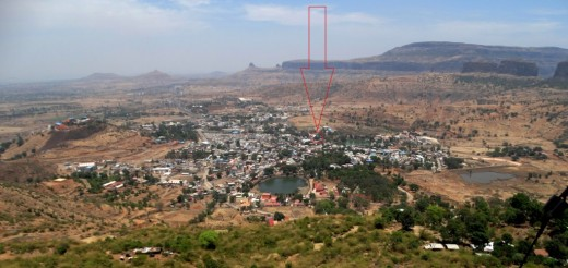 View of Trimbakeswar town from Bramha Giri. The Jyotirlingam temple has been marked with a red arrow & a circle