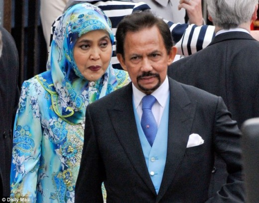 The princess don a blue baju kurung for an ceremony alongside the Western dressed Sultan,