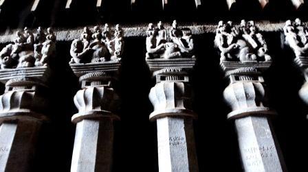 The decorated pillars inside the Chaityagriha