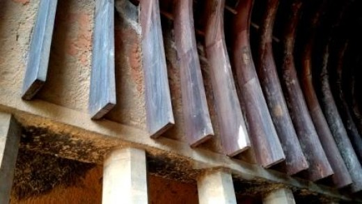 The lower ends of the arch type wooden ribs in the roof of Chaityagriha, Bhaja