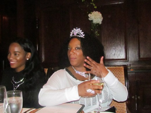 Chante, wore a crown during our family dinner on Friday evening for the first event of her bridal shower weekend. Her daughter LaShae, smiles at the joking of her mother's elegance.