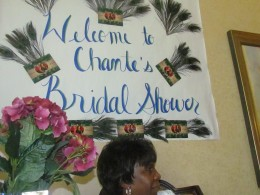 A sign that was created by my nieces Wanisha and Kasia for Chante's bridal shower as my sister Lean looks on. Lean, also gave Chante marital advice because she has been married to her husband Alexander for more than 50 years.