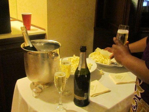 My nephew Mo Bey, husband of my niece Wanisha, who works at the hotel provided as a surprise champagne and popcorn after dinner during our shower weekend.