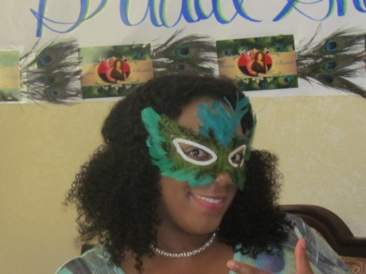 My daughter Chante, wore a mask made of peacock feathers which is her favorite.