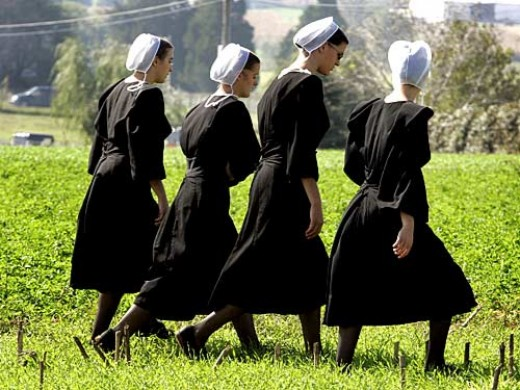 These Amish women would not think of dressing differently from the requirements of their church.