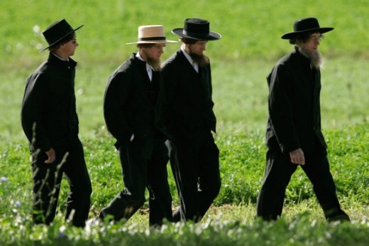 Amish men showing adherence to a strict dress code for their religion.