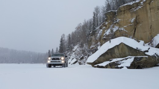 Checking out the cliffs and caves on frozen Charlie Lake B.C.