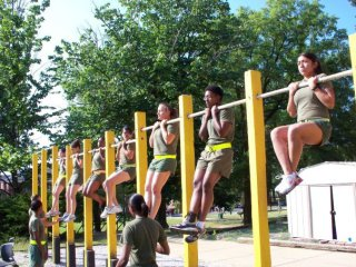 The Marine Corps is transitioning female Marines from the flexed-arm hang to pull-ups to test upper body strength.