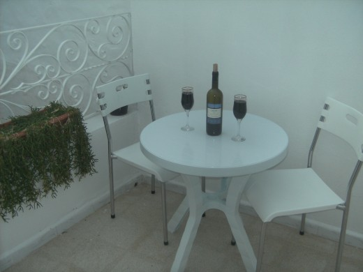 The balcony is a great place to relax in the Mediterranean sunshine and have a glass of wine or two!