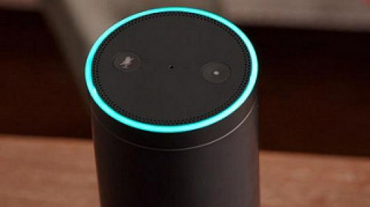 The Amazon Echo responds to voice commands and it stands 9.25 inches in height.