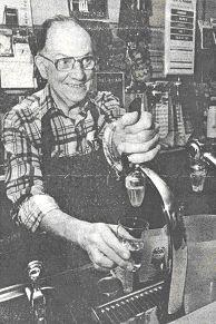 Mr. Fehrmann at his soda fountain.