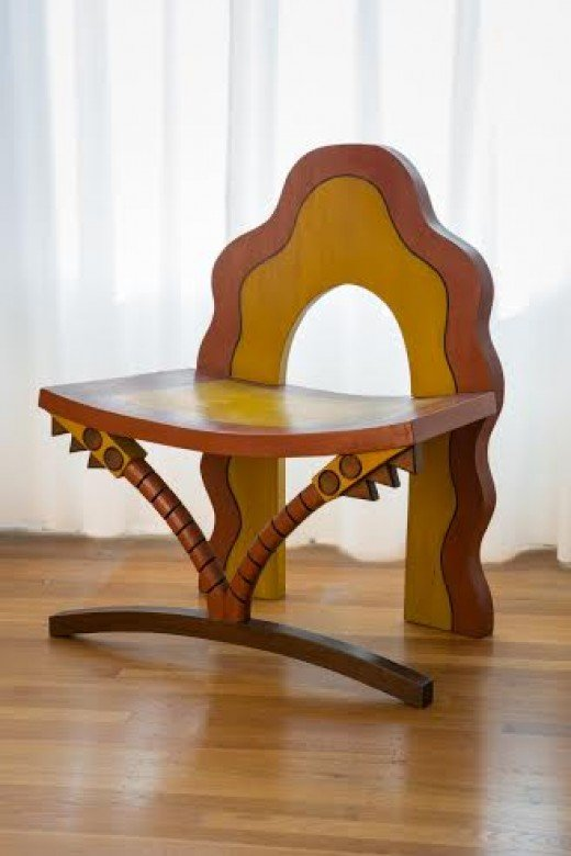 """""""African Throne""""; Carved wood and paint; 30in x24in x 17in. Carved Wood Chair (Three Quarter View)"""