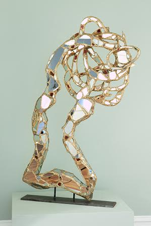 """Dance of Innovation""; Carved wood, mirror,glass and gold leaf; 60in x 32in x 5in."
