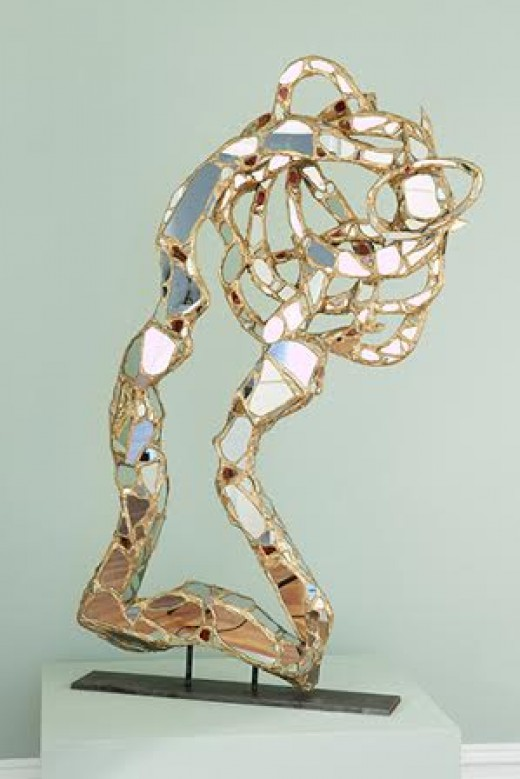 """""""Dance of Innovation""""; Carved wood, mirror,glass and gold leaf; 60in x 32in x 5in."""