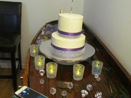 The delicious chocolate chip cake with vanilla icing was surrounded by candles for a nice setting.