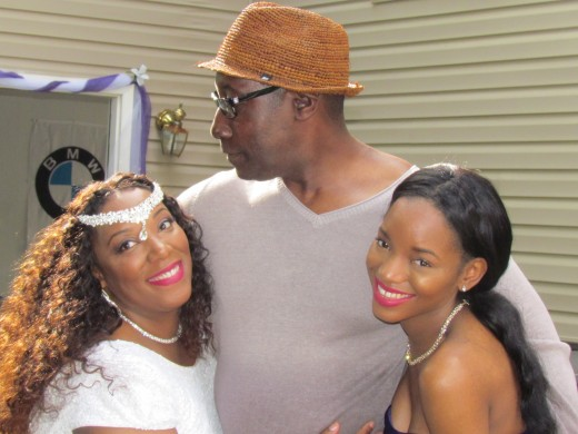 Proud father Sherman, poses with his daughter Chante and granddaughter LaShae.