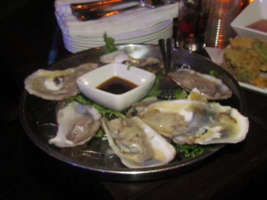 At the rehearsal dinner they feasted on such things as raw oysters which were fresh and delicious.