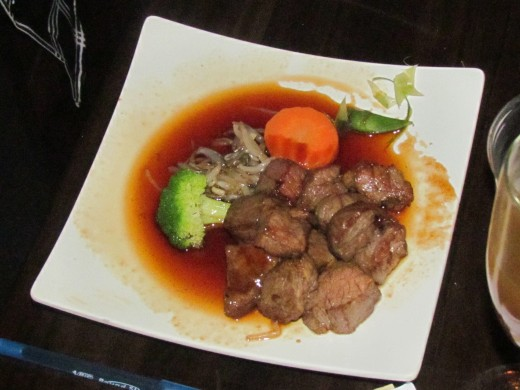 Steak in a delicious sauce with vegetables were ordered.