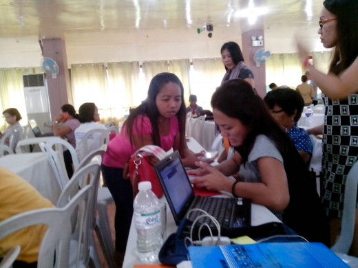 Solving a problem in the laptop, Photo Source: Ireno Alcala