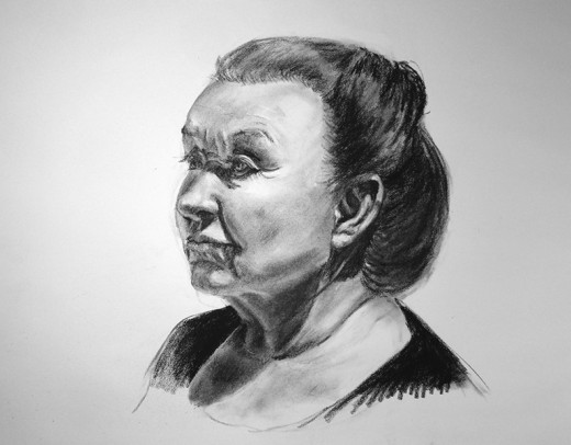 A face in charcoal.