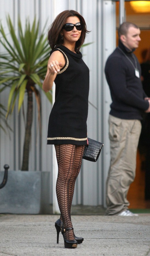 Eva sexy in a little black dress and fashionable stockings