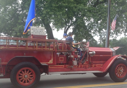 An antique fire truck in the 2015 4th of July parade in Warren, PA