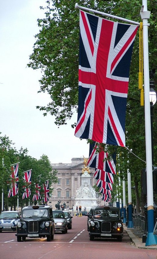 Union Jack flags line the Mall all the way up to Buckingham Palace home of the Head of State, Queen Elizabeth II.